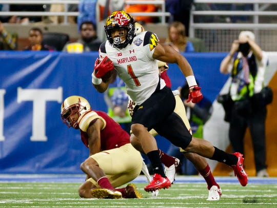 Maryland wide receiver D.J. Moore escapes a Boston