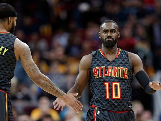 Atlanta Hawks' Tim Hardaway Jr., right, is congratulated by Malcolm Delaney after shooting a three-point basket in the second half of an NBA basketball game against the Cleveland Cavaliers, Friday, April 7, 2017, in Cleveland. (AP Photo/Tony Dejak)