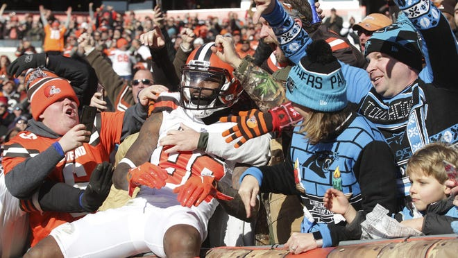 Cleveland Browns Jarvis Landry celebrates a touchdown reception  against the Carolina Panthers with fans in the Dawg Pound  in the first half at FirstEnergy Stadium on Sunday Dec. 9, 2018 in Cleveland, Ohio. Browns beat the Panthers 26 to 20.