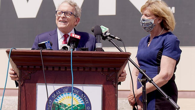 Ohio Gov. Mike DeWine, with wife Fran, speaks outsider Lordstown Motors on Wednesday following a plant tour.