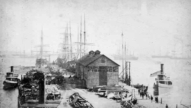 The bustling activity at Palafox Wharf is captured in this 1885 photo. The lumber industry brought ships and docks, which bought railroads and the ice houses, and these brought commercial fishing fleets before the end of the 19th century. All these industries attracted immigrants to the area.