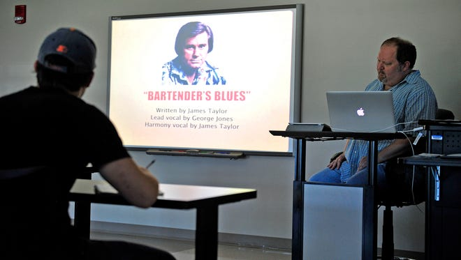 Odie Blackmon, right, teaches a class on George Jones at Middle Tennessee State University in Murfreesboro, Tenn., Thursday, Aug. 27, 2015.