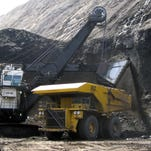 A shovel prepares to dump a load of coal into a 320-ton truck at the Black Thunder Mine in Wright, Wyo., in April 2007.