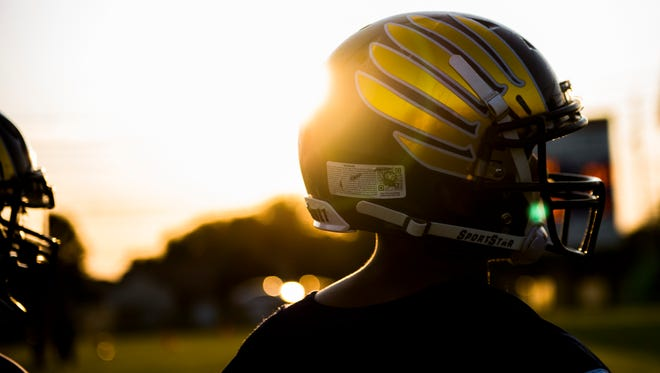 Stacy Dews looks off to his team as their practice before their game against Northeast on September 8, 2017.