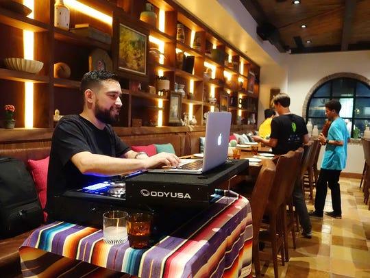 A DJ spins dance music every night but Mondays at Casa