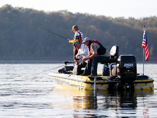 Paul Schmitz II fishes off the back of a boat during with professional anglers during the Fishing Dreams for Veterans event at Table Rock Lake on Wednesday, Nov. 2, 2016. Fish Tales angler J.P. Sell, Bass Pro Shops and Congressman Billy Long, took 21 disabled veterans on a fishing trip with professional anglers.