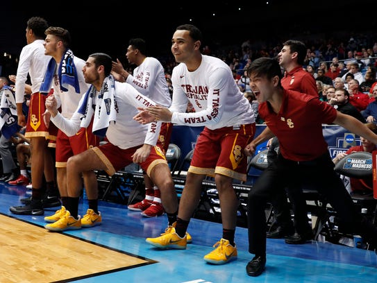 USC Trojans bench members celebrate a play against