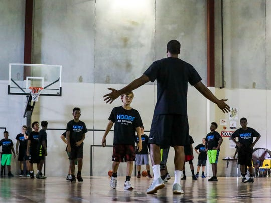 Dwayne Jackson, founder of Hoops On Mission, tries to reach inner-city Fort Myers, Florida, youth with his Bibles and basketball outreach program. Over the summer months he runs a youth basketball camp to keep the kids busy and a basketball in their hands. Jackson runs drills.