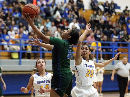 Montwood's Jordan Maxwell goes for a layup against Eastwood Tuesday night at Eastwood.