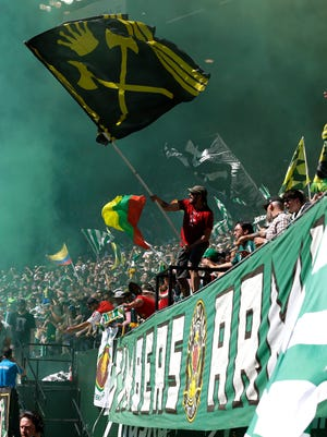 Portland Timbers supporters celebrate after a goal in the first half of an match against the Seattle Sounders.