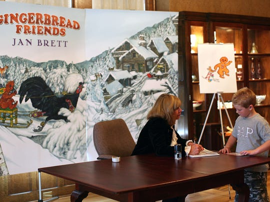 """Several lucky people received a personal signed copy of """"Gingerbread Friends"""" and a brief chat with best-selling author and artist Jan Brett on a book-signing tour stop at the Oshkosh Public Museum as seen in this file photo. Brett will do another book-signing May 13."""
