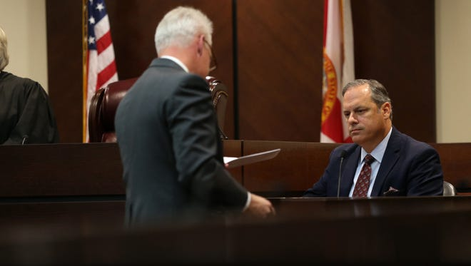 City Commissioner Scott Maddox is handed paperwork by attorney Thomas Bishop in a trial to determine his official residence, which is under question by frequent critic of City Hall Erwin Jackson at the Leon County Courthouse on Thursday, Dec. 1, 2016.