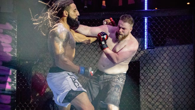 Iola-Scandinavia graduate Austen Lane (left) will battle controversial ex-NFL star Greg Hardy in an all-NFL MMA clash in June.
