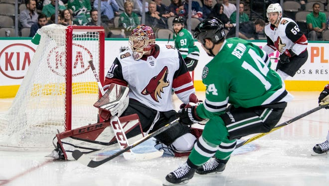 Oct 17, 2017: Arizona Coyotes goalie Adin Hill (31) stops a shot by Dallas Stars left wing Jamie Benn (14) during the second period at the American Airlines Center.