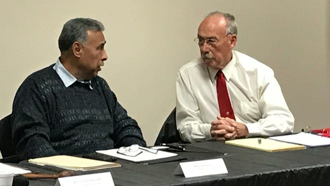 In this archive photo, Tulare hospital board members Mike Jamaica, right, and Stephen Harrell speak during a meeting.