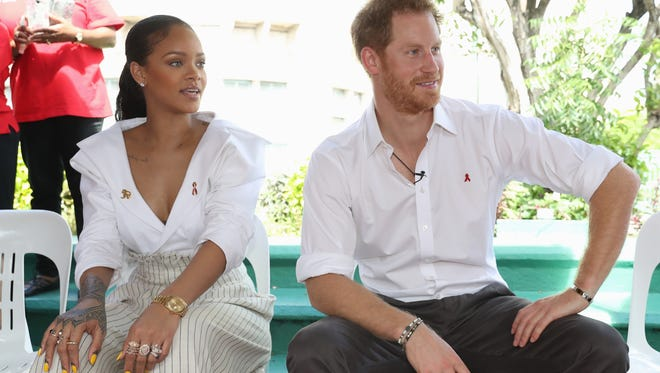 Rihanna and Prince Harry attend the 'Man Aware' event held by the Barbados National HIV/AIDS Commission on the eleventh day of an official visit on Dec. 1, 2016 in Bridgetown, Barbados.