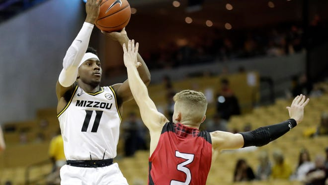 Missouri's Mario McKinney Jr. (11) shoots over Incarnate Word's Drew Lutz (3) during the second half of an NCAA college basketball game Wednesday, Nov. 6, 2019, in Columbia, Mo. (AP Photo/Jeff Roberson)
