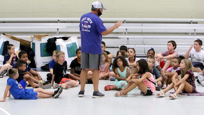 """Evans Boys & Girls Club Unit Director Johnny Young gathers members around to announce the start of the """"Great Evans Treasure Hunt,"""" Thursday, July 2, 2020, at the southside club. Much like the radio hunts held in the area, clues are posted daily and members search the club for the prize."""