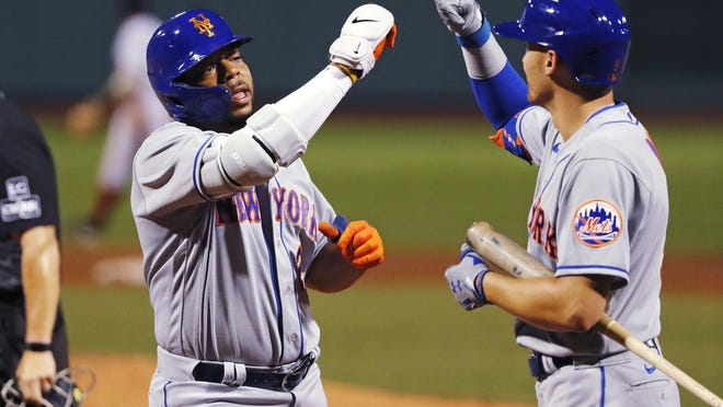 Dominic Smith (left) celebrates his deciding three-run homer with Mets teammate Brandon Nimmo on Monday. New York eased past the Red Sox, 7-4.