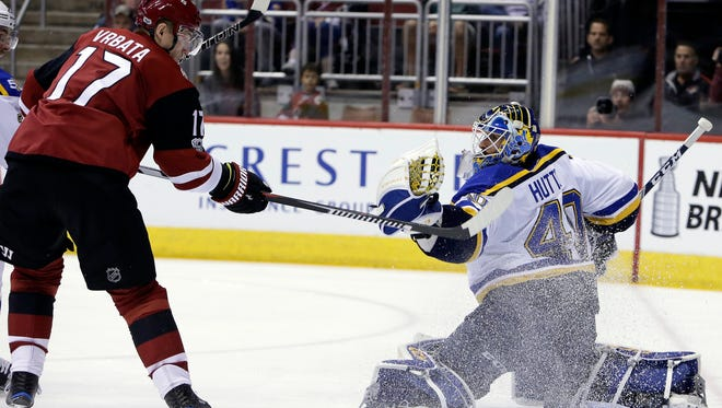 St. Louis Blues goalie Carter Hutton (40) makes the save on Arizona Coyotes right wing Radim Vrbata in the second period during an NHL hockey game, Wednesday, March 29, 2017, in Glendale, Ariz. (AP Photo/Rick Scuteri)
