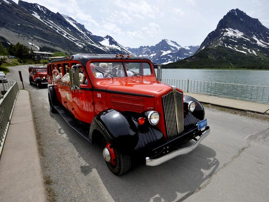 Red Bus Tours take off from the Many Glacier Hotel at Swiftcurrent Lake. All Red Bus Tours are operating despite the Reynolds Creek fire.