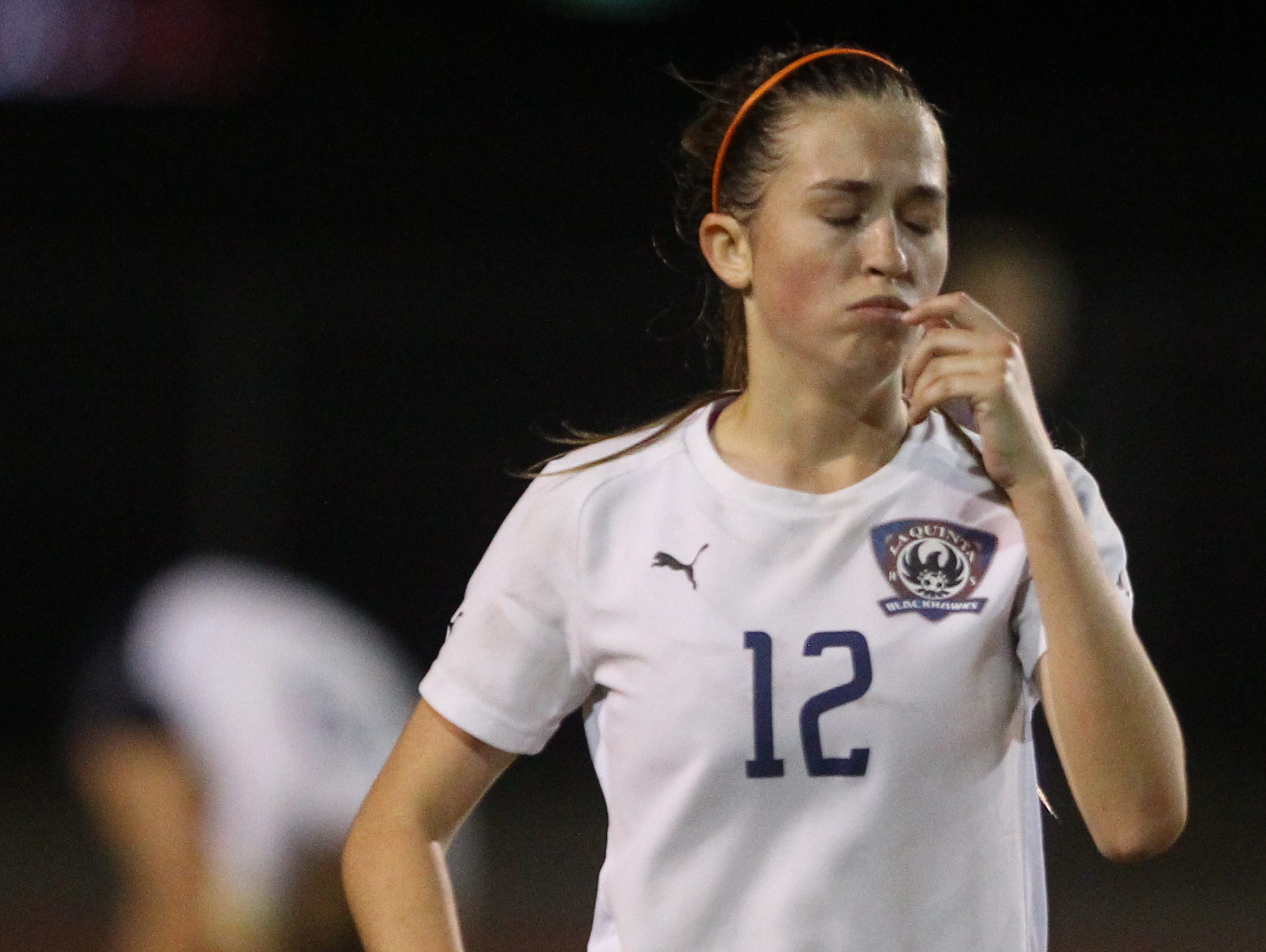 Lauren Costello of La Quinta High School girls' soccer team is dejected after her team misses a shot on goal against Paloma Valley High School during their second round CIF game at La Quinta on February 21, 2017. La Quinta lost 0-1.
