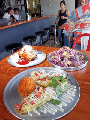 The Chiles Rellenos, stuffed with nopales and corn, are among the popular dishes offered at Sabertooth Food Co., 4012 N. Mesa. Also on the menu are the Kale Caeser Salad, upper right, and for dessert, the Sabertooth Elvis, a tempura-battered and fried peanut butter sandwich made with homemade jam and bananas.
