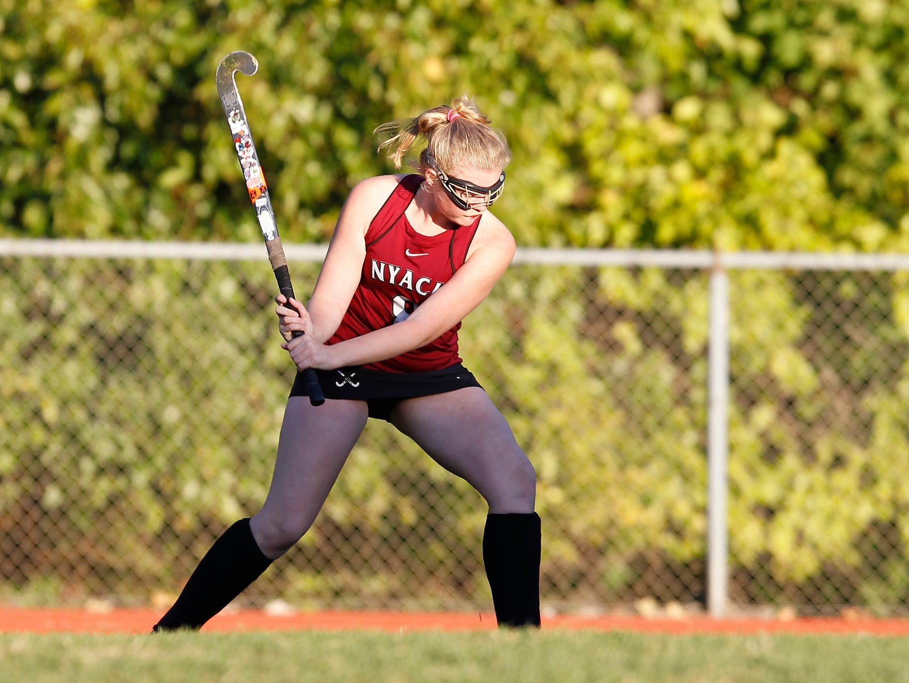 Nyack's Olivia Demetres (8) fires a pass up the sideline during a varsity field hockey game at Pearl River High School on Friday, Oct. 16, 2015.