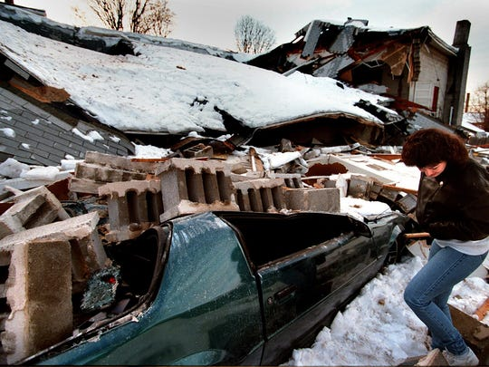 A church is crushed under the weight of the snow a week after the Blizzard of 1996.