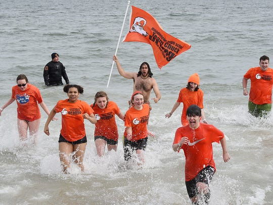 The 25th annual Lewes Polar Bear Plunge was held at Rehoboth Beach on Sunday.