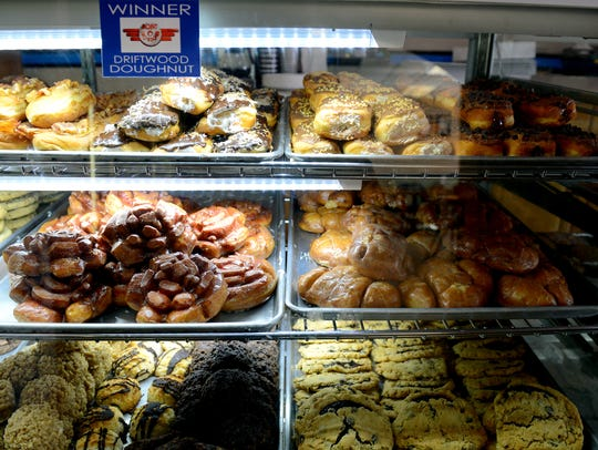 Trays of doughnuts and cookies sit for sale at Cops