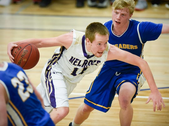 Melrose's Dillon Haider drives the ball around St. Cloud Cathedral's William Kranz during the first half Tuesday, Jan. 17 at Cathedral High School. Haider is the Times Media Prep Athlete of the Week.
