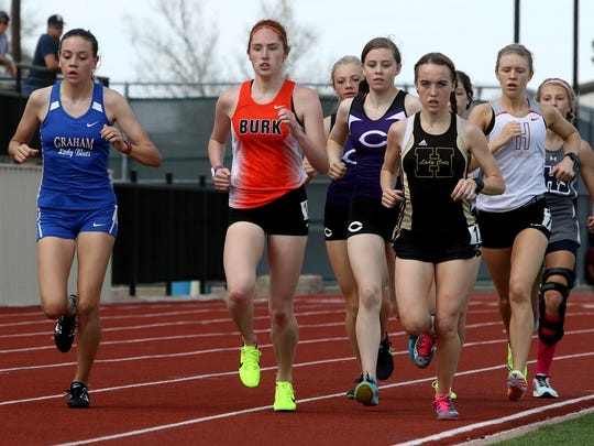 A pack runs in the Division II 1600 meter run Saturday, March 18, 2017, at the PK Relays in Graham. Madelaine Johnston finished first with a time of 5:29.58.