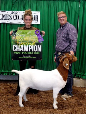Macin Hager showed the champion meat market doe. Hainsley Hatfield holds banner. Hager also was the grand champion for senior showmanship and named the supreme showman on Tuesday during Meat Goat Showmanship at the Holmes County Fair.