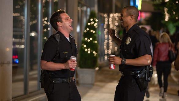 AP FILM REVIEW LETS BE COPS A ENT