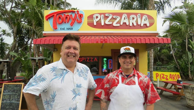 "Bruce Barrios, son of Tony's Pizzaria founder Johnny ""Tony"" Barrios, and Abel Nava, nephew of the elder Barrios, pose with the pizzeria's new sign in downtown Ventura. The sign ""is part of our efforts to honor Dad's legacy."" says Bruce Barrios."