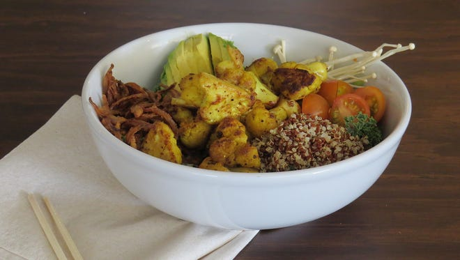Turmeric-dusted cauliflower is paired with quinoa, avocado and enoki mushrooms in the Golden Flower Bowl, a vegan option at Ojai Bowls.