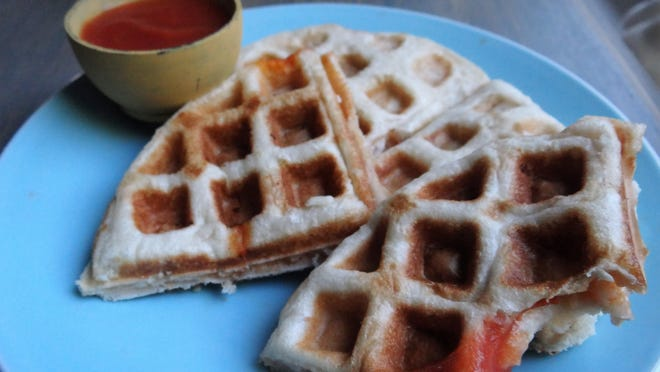 Waffle irons aren't just for waffles anymore. Try making a homemade calzone with either homemade or store-bought pizza dough and whatever ingredients you prefer.
