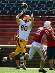 Brenden Bates catches a deep pass for Moeller. Bates is the brother of University of Cincinnati tight end Doug Bates, who also went to Moeller.
