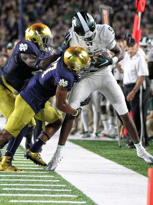 Michigan State receiver Donnie Corley is pushed out of bounds after a catch against Notre Dame on Sept. 17, 2016 in South Bend, Ind.