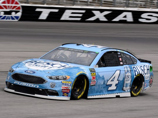 Kevin Harvick enters pit road as he comes out of Turn 4 during a practice session for a NASCAR Cup series auto race in Fort Worth, Texas, Friday, April 6, 2018. (AP Photo/Larry Papke)