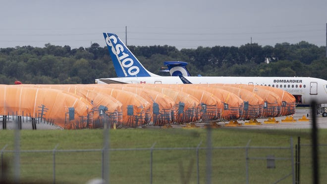 Completed Boeing 737 MAX fuselages, made at Spirit Aerosystems in Wichita, sit covered in tarps near the factory. On Friday, aircraft parts maker Spirit AeroSystems announced it is laying off 2,800 employees at its Wichita facility due to the grounding of the Boeing 737 Max.