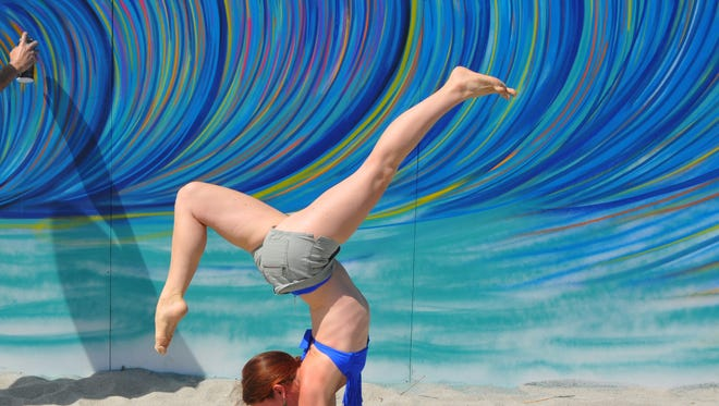 On the active agenda this weekend on the Space Coast- yoga, beach running and craft beer- to name a few. Photo: Sarah Pulcino did yoga poses in the sand.