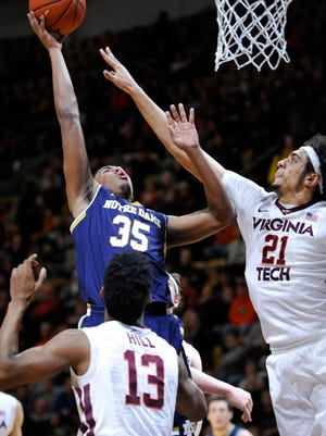 Jan 22, 2015; Blacksburg, VA, USA; Notre Dame Fighting Irish forward Bonzie Colson (35) shoots over Virginia Tech Hokies forward Satchel Pierce (21) in the first half at Cassell Coliseum. Mandatory Credit: Michael Shroyer-USA TODAY Sports