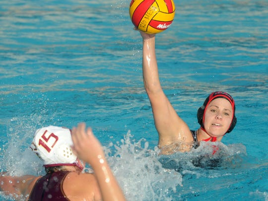 Rio Mesa's Kayla Wallace passes the ball against Oxnard during last week's Pacific View League opener, won by the Spartans. Rio Mesa has won three straight league titles.