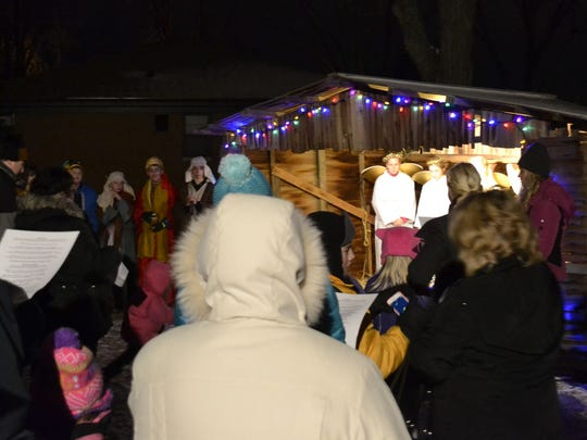 Bundled-up attendees sing carols as they stand around a living Nativity during one of three Live Nativity Worship services held outside Our Saviour Lutheran Church in Green Bay on Wednesday night, Dec. 17. The Christmas event, which has been presented annually by the church for nearly 20 years, included seventh- and eighth-grade confirmation students from the church recreating The Nativity of Jesus in Bethlehem. Guests were invited after each service to warm up in the school gymnasium by having a soup and bread supper as well as dessert. Donations of nonperishable food items also were accepted for Paul's Pantry.
