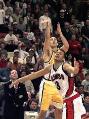 FILE - In this March 13, 1998, file photo, Valparaiso's Bryce Drew (20) follows through with his winning 3-point shot at the buzzer over Mississippi's Jason Flanigan (3) in an NCAA tournament game. At left is Valparaiso coach Homer Drew watching his son's shot.