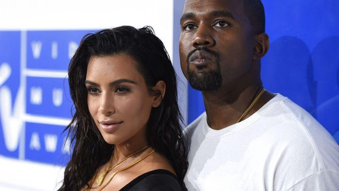 One Vox caller talks about Kanye West running for president. Shown: Kim Kardashian West, left, and Kanye West at MTV Video Music Awards in New York in this file photo.