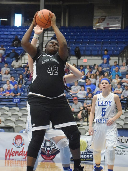 Neville High School's Tyeisha Scott (42, front) goes for two against South Lafourche in the LHSAA Class 4A semifinals held Tuesday, Feb. 27, 2018 at the Rapides Parish Coliseum in Alexandria.