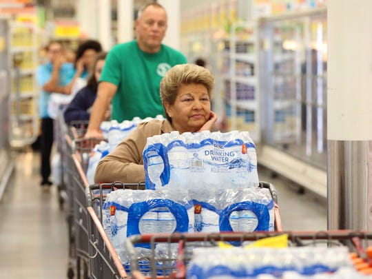 Corpus Christi residents stand in line to pay for cases of water during a three-day tap water ban in December 2016.